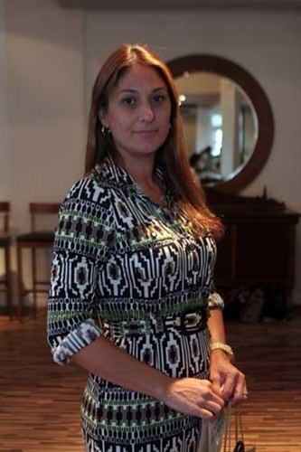 Claudia Awada circula pela tarde beneficente